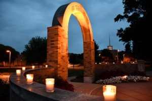 Arch with lit candles